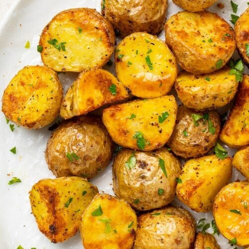 Roasted potatoes on a white platter