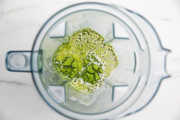 Ingredients for iced matcha latte in a blender