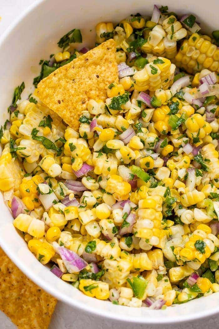 Close-up of corn salsa ina bowl with chips