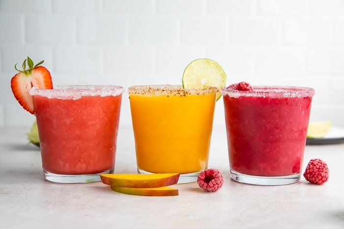 Three different flavors of fruity margaritas
