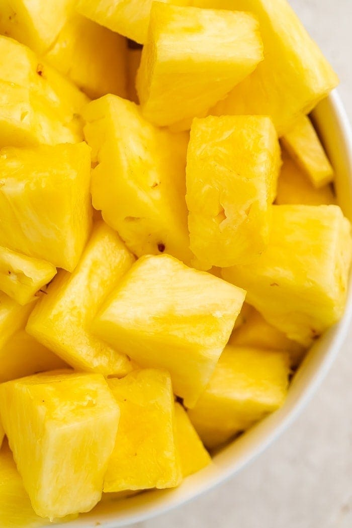 Close-up of chunks of pineapple in a bowl