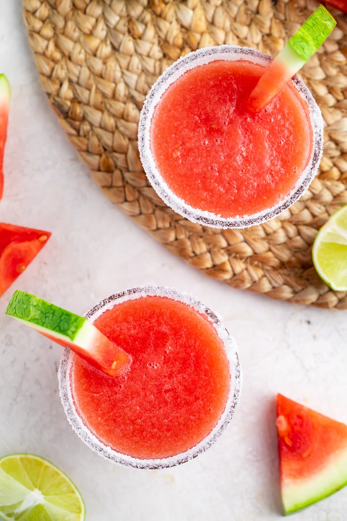 Overhead of two glasses of watermelon margaritas