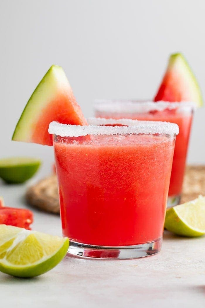 Watermelon margarita in a glass with a slice of watermelon