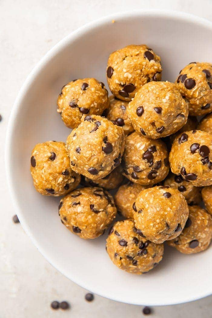 Peanut butter and chocolate chip energy balls in a bowl