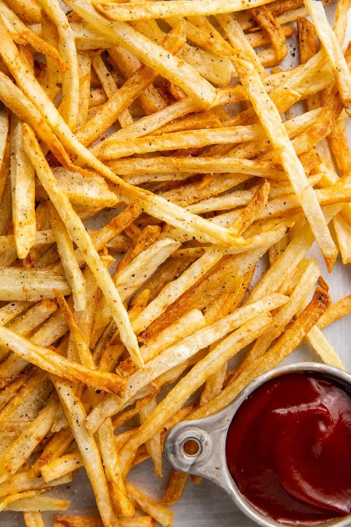 Close-up of air fryer french fries with a side of ketchup