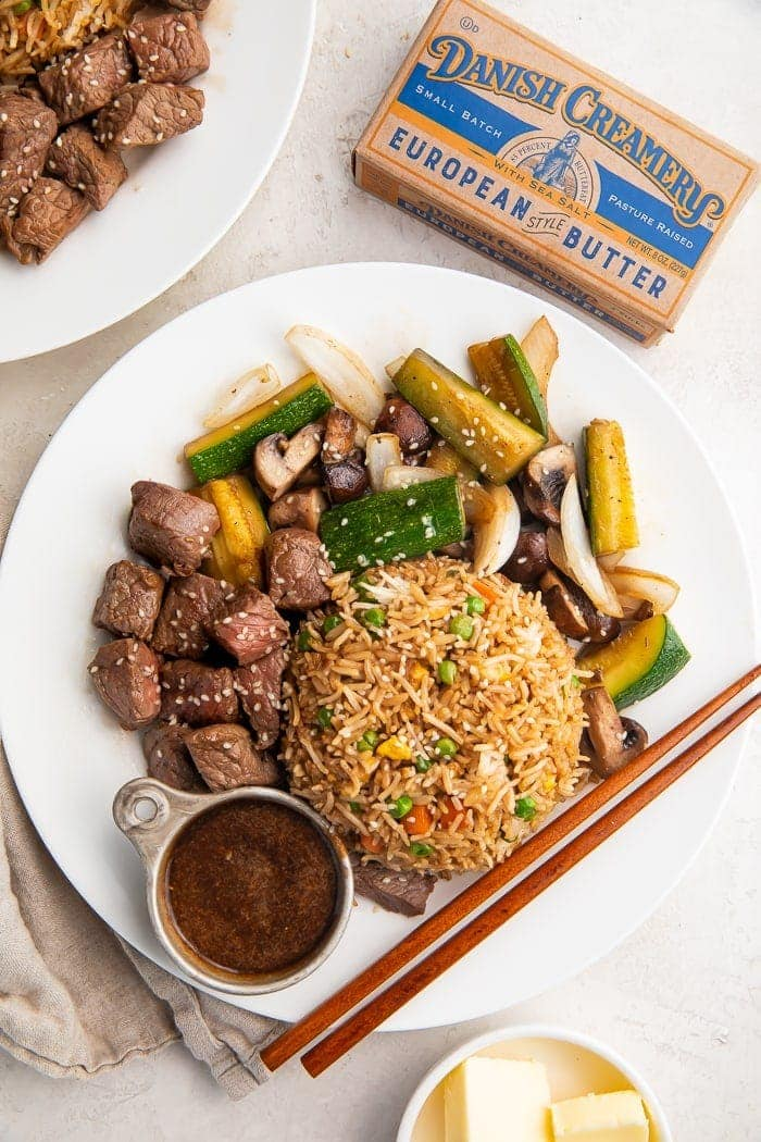 Hibachi steak with fried rice and vegetables on a plate