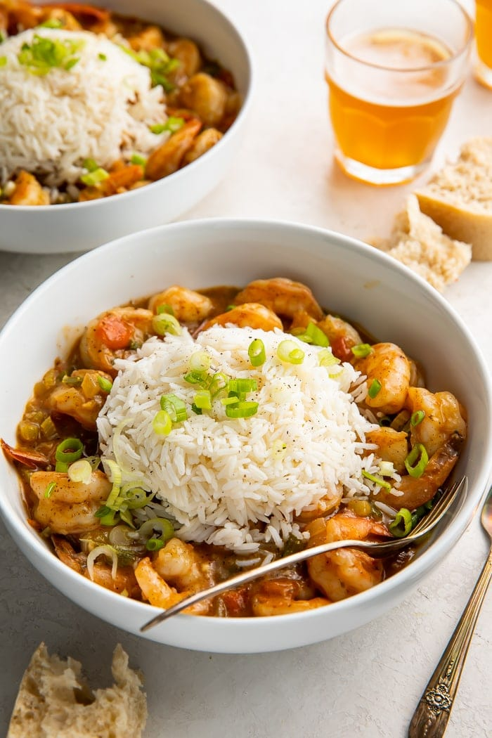 A bowl of shrimp etouffee with a spoon in it
