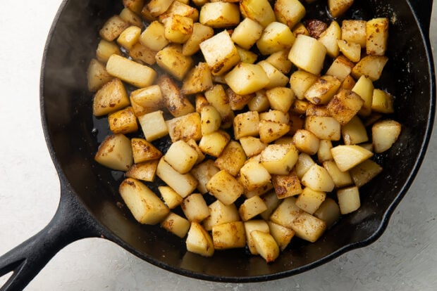 Gluten free roasted red potatoes in a cast iron skillet