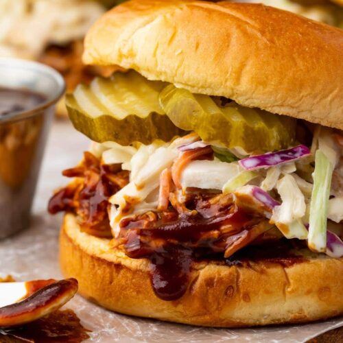 Sandwich with Instant Pot BBQ chicken topped with coleslaw