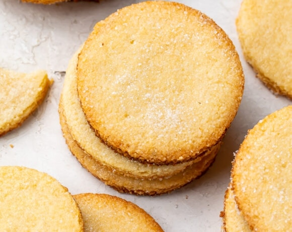 Keto shortbread cookies in stacks on a countertop