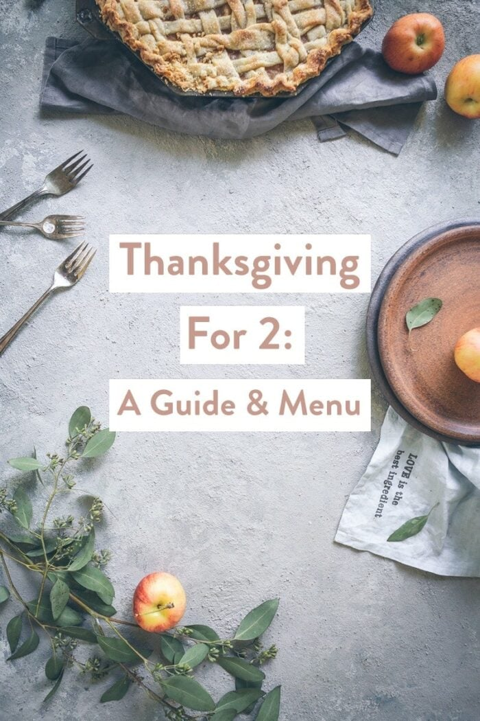A tablescape with Thanksgiving foods with the text Thanksgiving For 2: A Guide & Menu