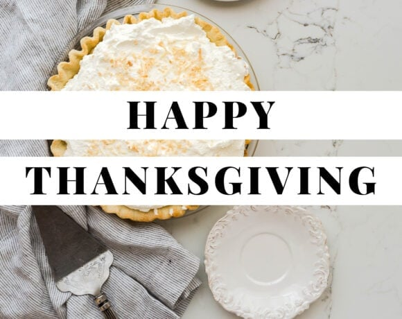 Graphic with black text reading Happy Thanksgiving against a white text background on top of a photo of pie on a marble countertop