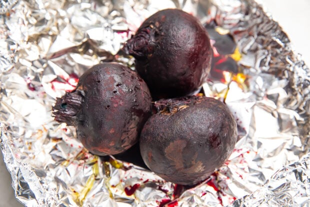Whole roasted beets on sheet of aluminum foil