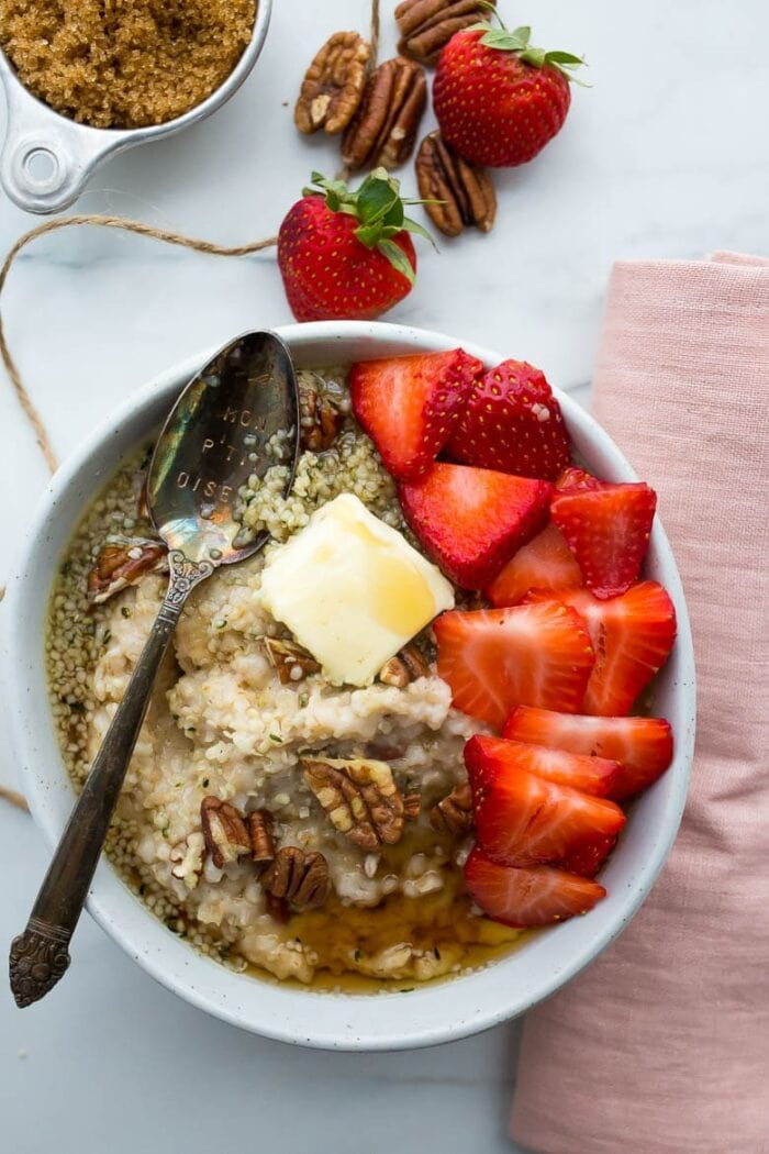 Oatmeal with pecans, butter, and strawberries