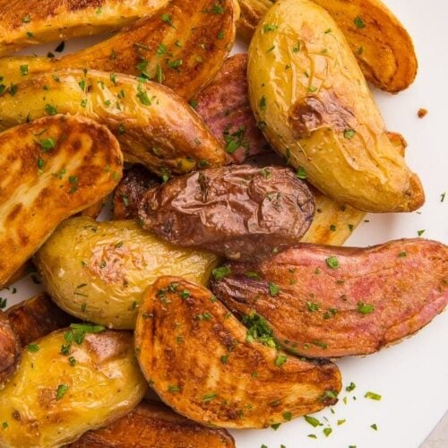 Roasted fingerling potatoes on a white plate