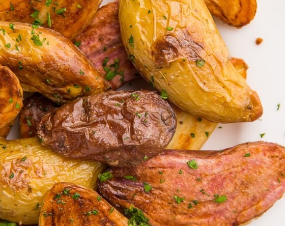 Overhead shot of fingerling potatoes on a white plate