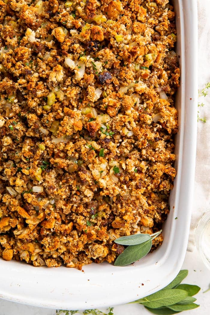 Close-up overhead shot of sausage stuffing in a white baking dish