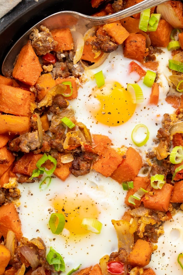 Close-up overhead shot of sweet potato hash in a skillet