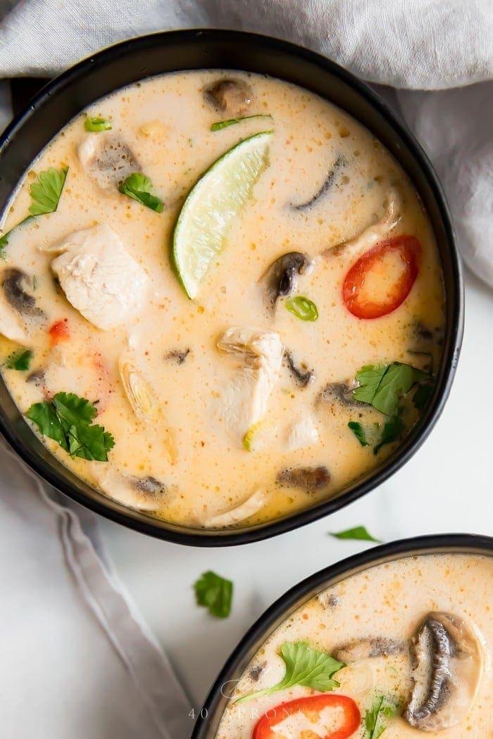 Black bowls with tom kha soup