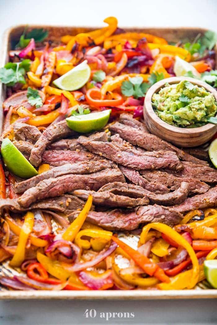 Fajita peppers and steak on a sheet pan