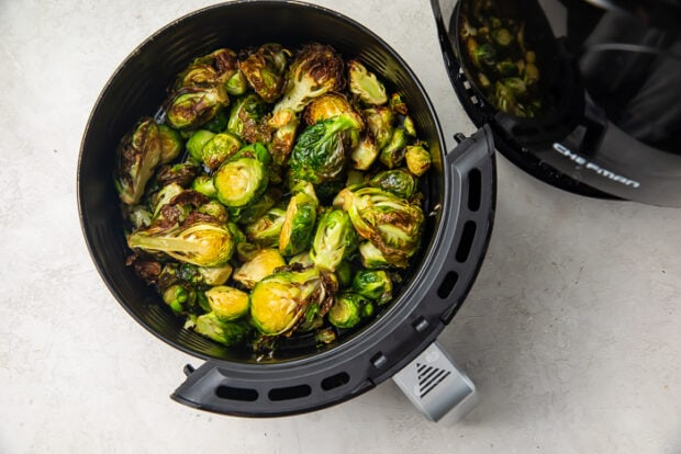Fried brussels sprouts in air fryer basket