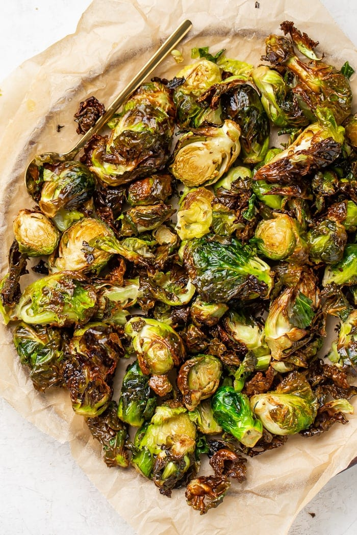 Air fryer brussels sprouts on a parchment lined plate