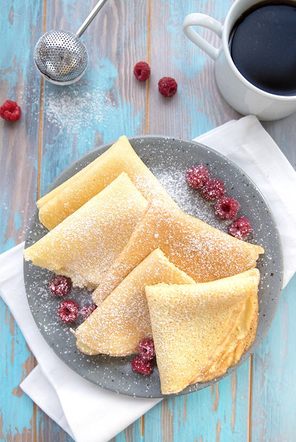 Almond flour crepes in a blue bowl