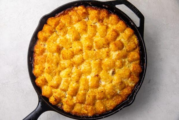 Baked tater tot breakfast casserole in a cast iron skillet
