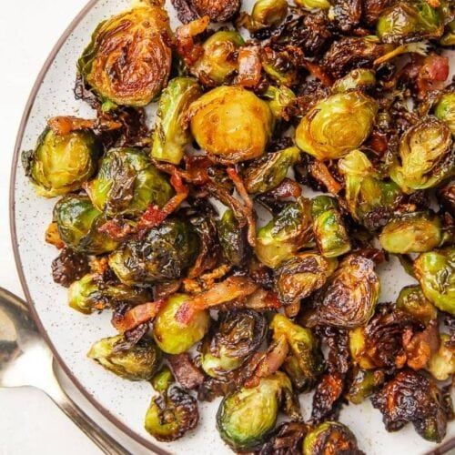 Lifestyle photo of a plate full of brussels sprouts and bacon