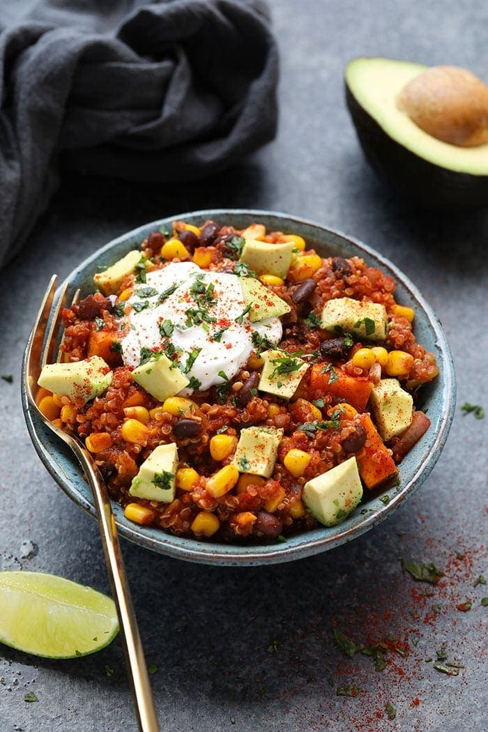 Vegetarian crockpot mexican quinoa in a grey bowl with a fork