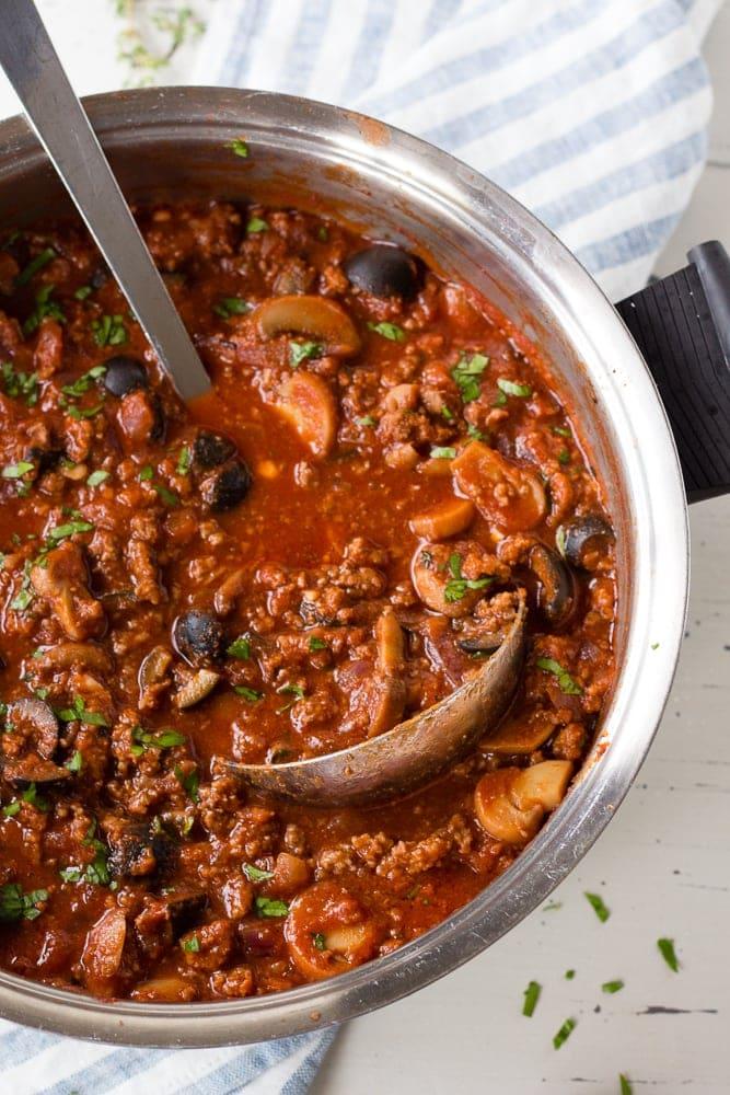A soup pot of Whole30 tomato meat sauce