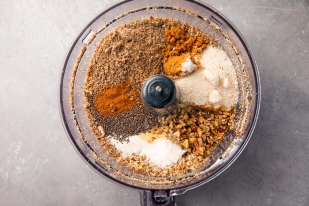 Nuts and seasonings for keto granola in a food processor bowl