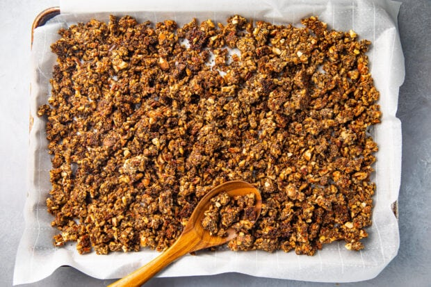 Baked keto granola on a sheet pan with parchment paper