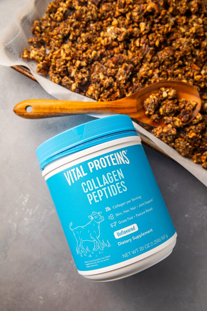 Vital Proteins collagen peptides container next to a sheet pan of keto granola