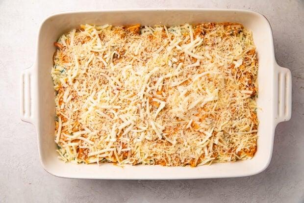Unbaked keto lasagna in a white ceramic baking dish