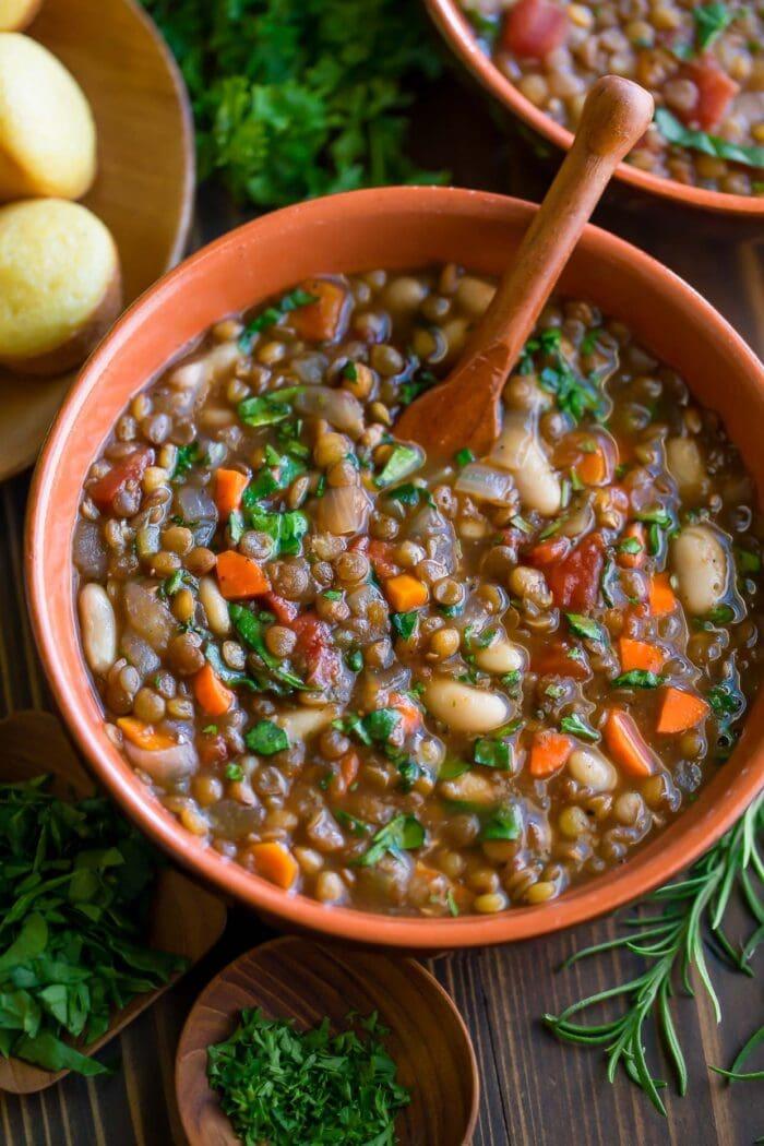 A red bowl of vegetarian slow cooker italian lentil soup