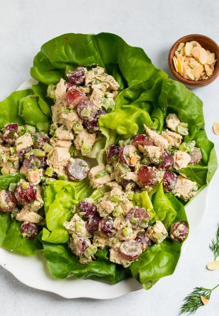 Whole30 chicken salad in lettuce cups on a white plate