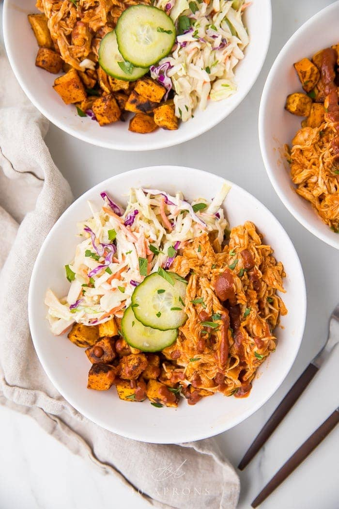 Paleo bbq chicken bowls with coleslaw and sweet potatoes