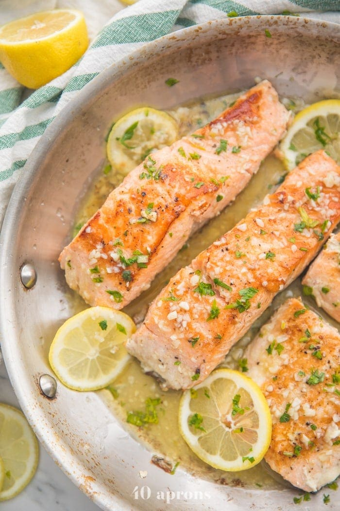 40 Aprons lemon garlic salmon in a saute pan