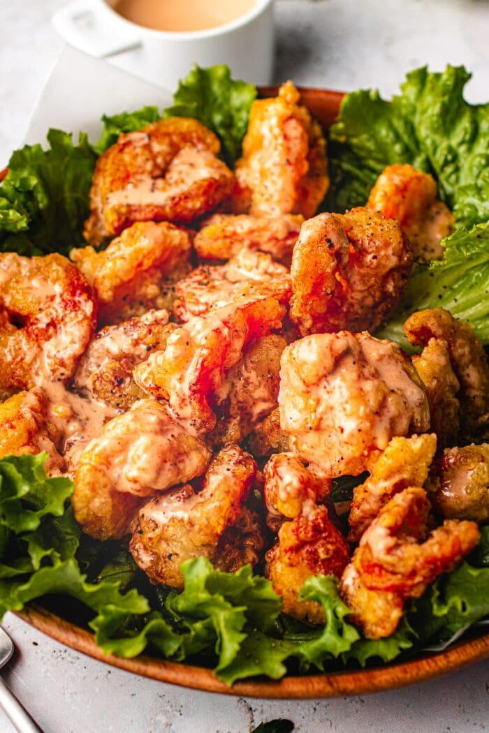 Paleo bang bang shrimp on a bed of lettuce