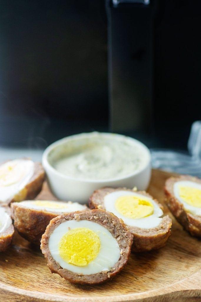 Scotch eggs on a cutting board