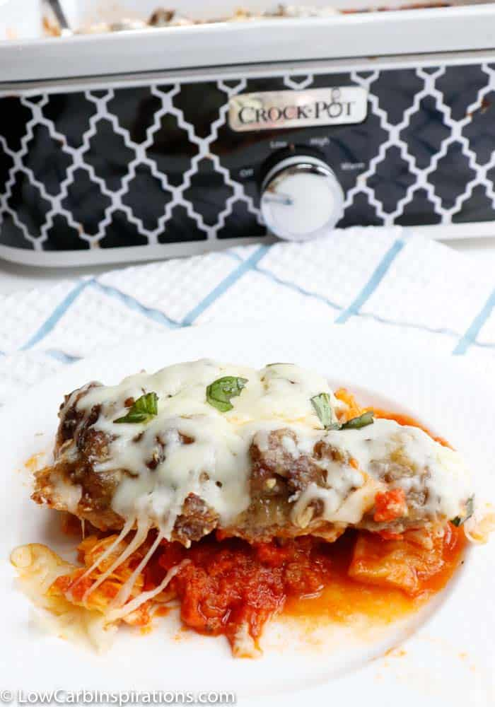 Low carb meatball casserole in front of a patterned slow cooker