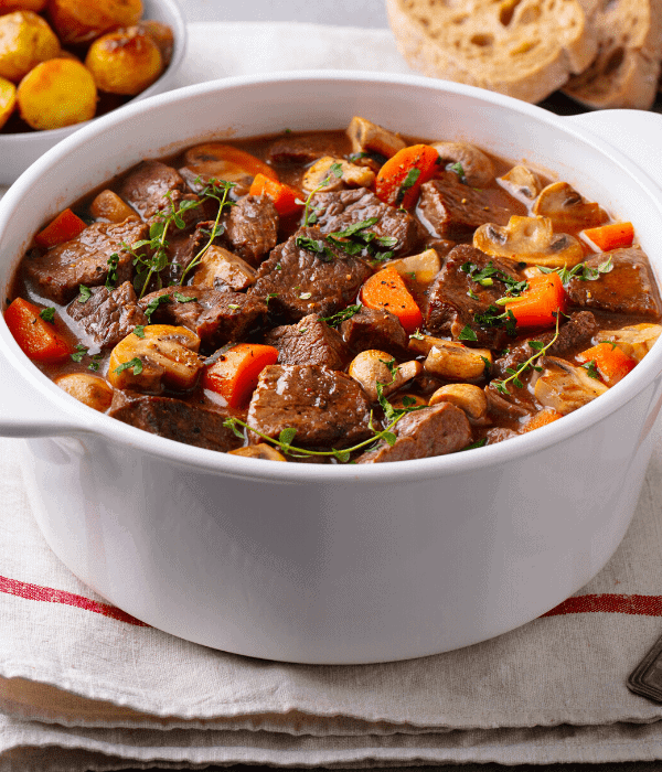 A white bowl of slow cooker beef stew