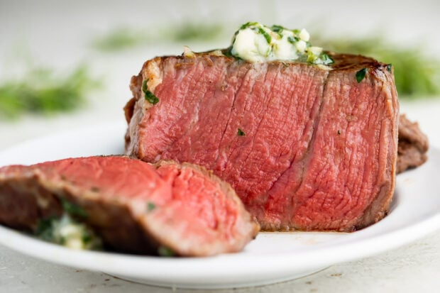 Medium rare sous vide filet mignon topped with herb butter