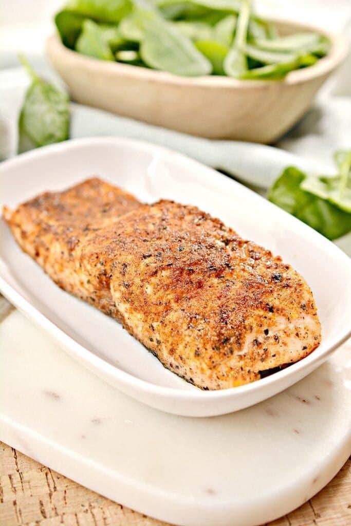 Blackened air fryer keto salmon filets on a white platter