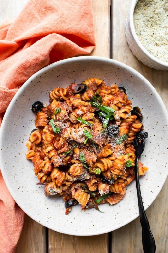 An eggshell white bowl with Instant Pot vegan Italian pasta