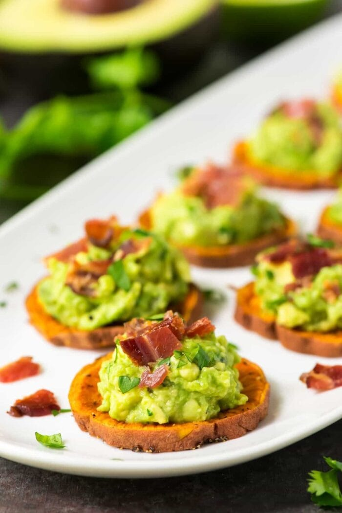 Sweet potato medallions topped with avocado and bacon