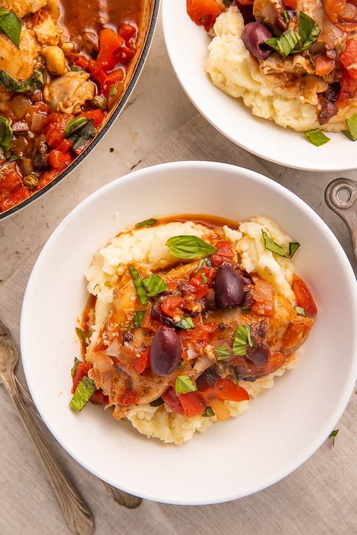 Plated Whole30 chicken cacciatore on top of mashed potatoes