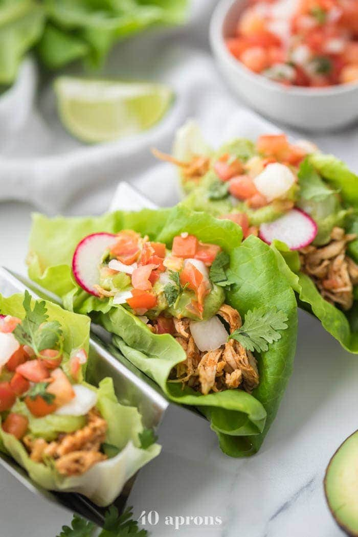 Low carb chicken and lettuce tacos in a silver metal taco holder