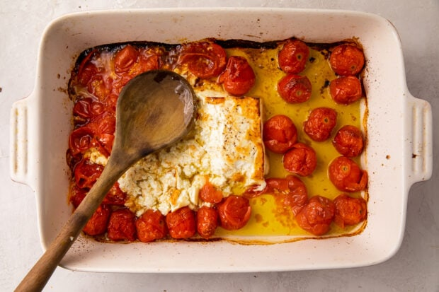 Baked feta and tomatoes in a casserole dish